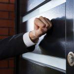 Businessman knocking the door