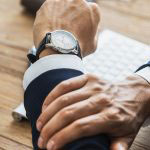 Business man checking watch