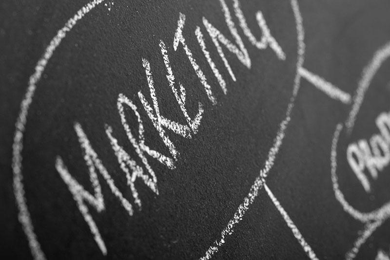 Marketing written on a chalkboard