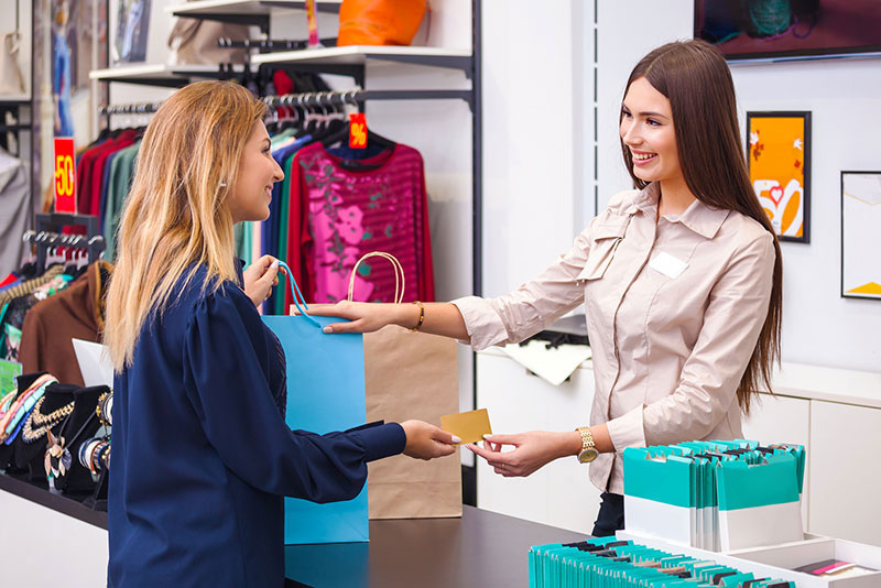 Young woman buying from store