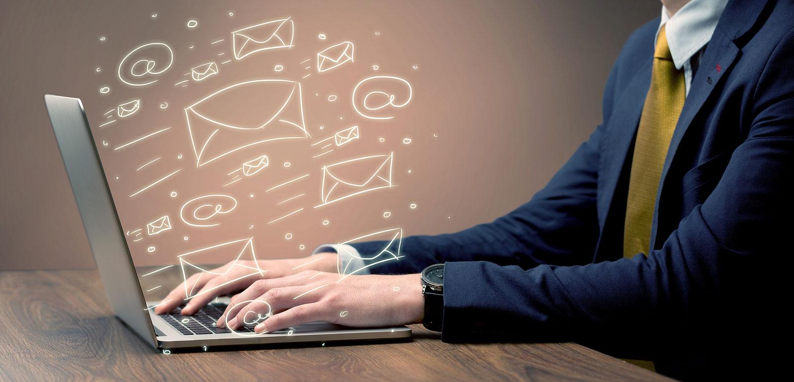 Businessperson sending email