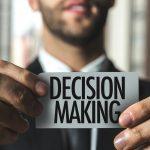 Businessman holing decision making card