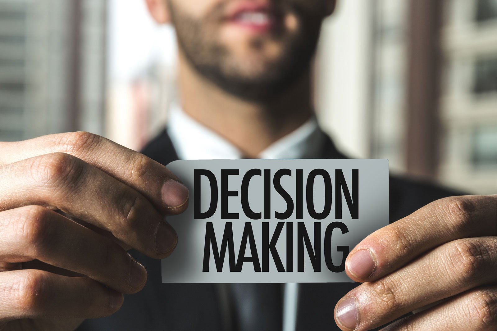 Businessman holing decision making card