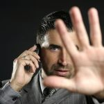 Angry businessman saying stop