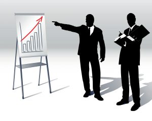 Businessmen with graphs