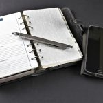 Organiser with a pen and mobile phone
