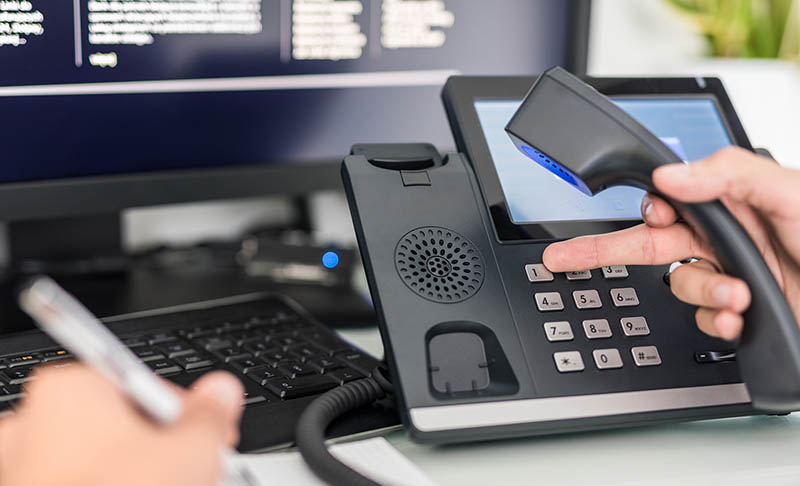 Salesperson making cold calls