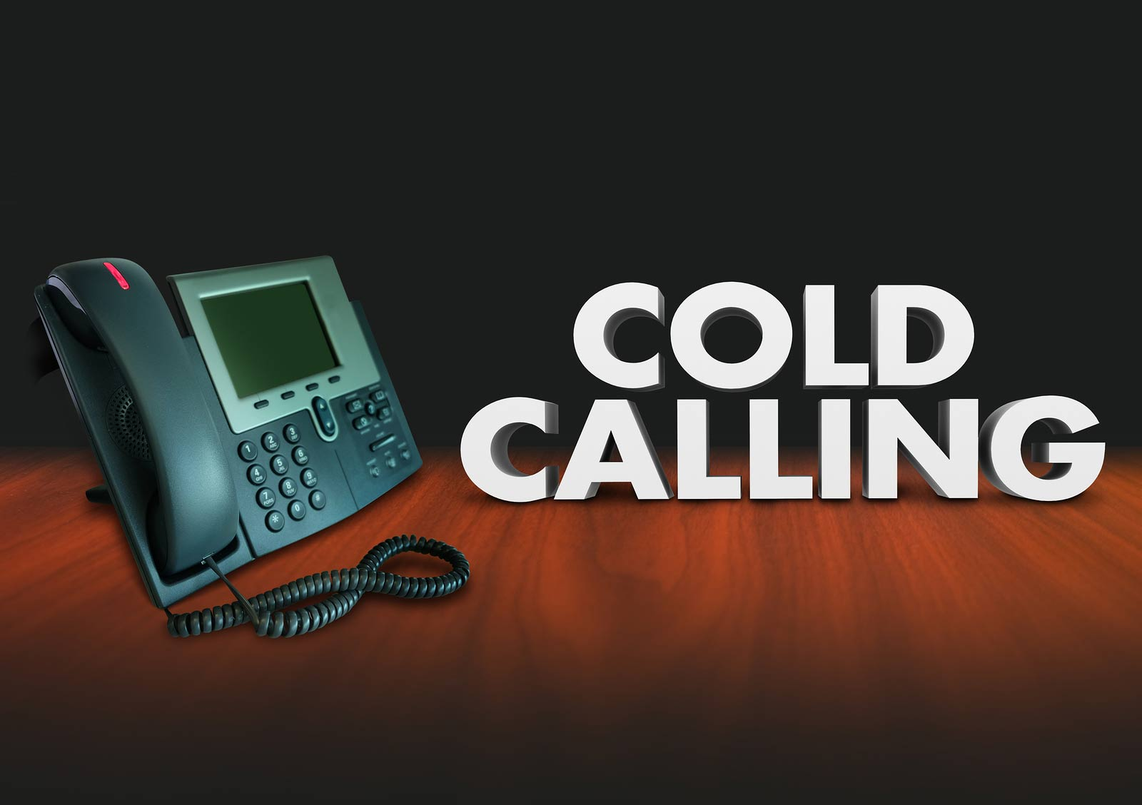 Cold Calling words in 3d letters beside a telephone to illustrat