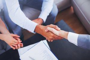 Salesman shaking hands