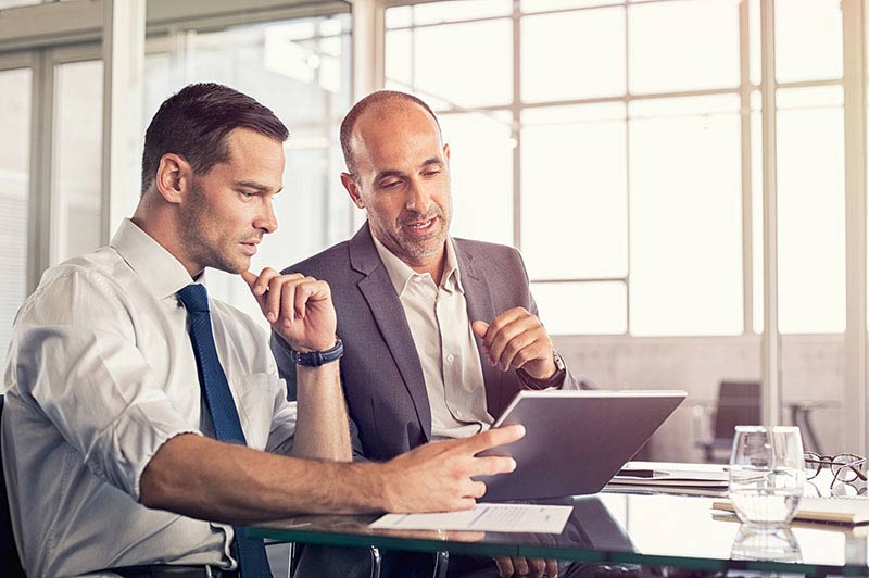 Businessman using a digital tablet to discuss information with s