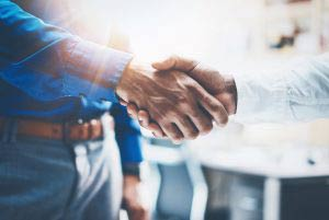 Salesmen shaking hands