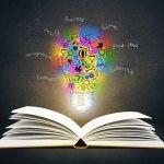 Book with lightbulb ideas