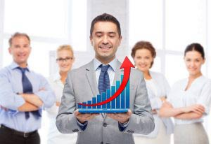 Sales manager holding increasing graph