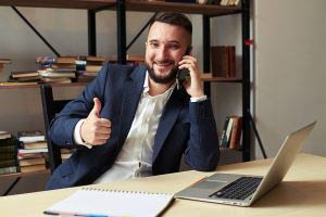 Businessman on the phone with thumbs up