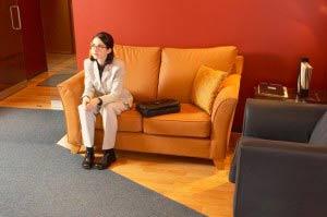 Woman on orange sofa