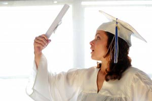 Happy young woman, just graduated with diploma