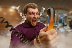 Angry man speaking on the phone