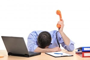 Exhausted Businessman Holding phone