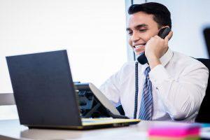 happy salesman talking on phone