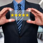 Businessman holding five star