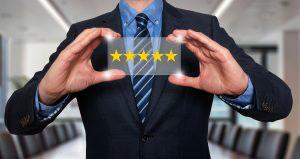 Businessman holding five star