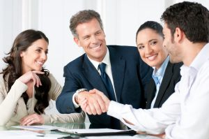 Mature businessman shaking hand