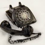 old style phone on snow