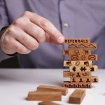 Wooden blocks showing referral concept