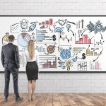 Business people with business map