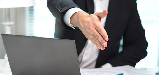Sales person shaking hands after arranging a deal
