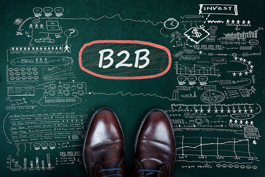 B2B word and business shoes on chalkboard