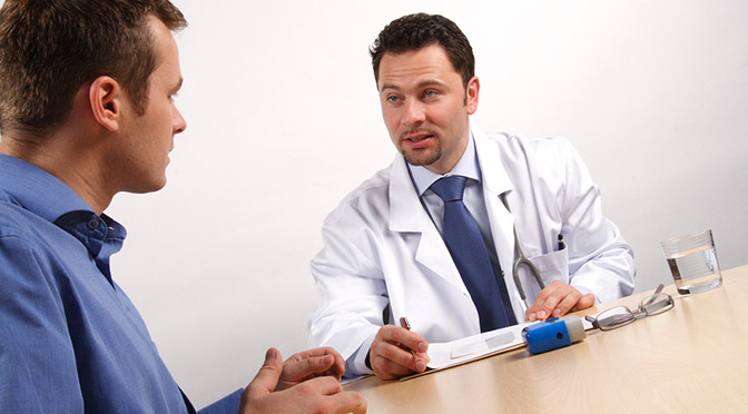 Two men discussing doctor and patient - visit in the office